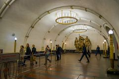 MOSCOW, RUSSIA- APRIL, 29, 2018: People walking inside of Mayakovskaya subway station in Moscow, Russia, Stalinist. Architecture, one of the most famous Metro Royalty Free Stock Photo