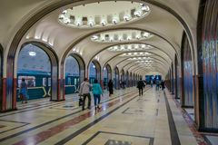 MOSCOW, RUSSIA- APRIL, 29, 2018: People walking inside of Mayakovskaya subway station in Moscow, Russia, Stalinist. Architecture, one of the most famous Metro Royalty Free Stock Images