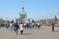 Moscow, Russia, April,20,2014, People walking near pavilion No. 1 Central (the House of the peoples of Russia) Royalty Free Stock Photography