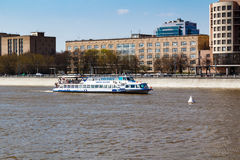 MOSCOW, RUSSIA - APRIL 30, 2017: Pleasure boats on the background of Berezhkovskaya Embankment Moskva River Royalty Free Stock Image