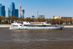 MOSCOW, RUSSIA - APRIL 30, 2017: Pleasure boats on the background of International Business Center Moscow City Royalty Free Stock Photography