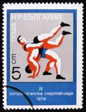 Wrestling, 4 Republics Spartakiad, circa 1974. MOSCOW, RUSSIA - APRIL 2, 2017: A post stamp printed in Bulgaria shows Wrestling, 4 Republics Spartakiad, circa Stock Image