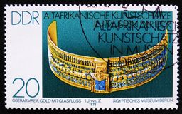 MOSCOW, RUSSIA - APRIL 2, 2017: A post stamp printed in DDR (germany) shows a golden neckle with treasure stones, the series. Old African Art Treasures, circa stock photos