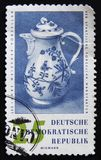MOSCOW, RUSSIA - APRIL 2, 2017: A post stamp printed in DDR (Ger. Many) shows porcellain jur devoted to 250 anniversary of the porcellain production fabric Stock Images