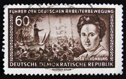 MOSCOW, RUSSIA - APRIL 2, 2017: A post stamp printed in DDR (Ger. Many) shows Rosa Luxemburg, Marxist theorist, philosopher, economist and stock photos