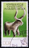 MOSCOW, RUSSIA - APRIL 2, 2017: A post stamp printed in DDR (germany) shows a stone figure of bull, the series 'Old African Art T. MOSCOW, RUSSIA - APRIL 2, 2017 stock image