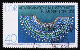 MOSCOW, RUSSIA - APRIL 2, 2017: A post stamp printed in DDR (germany) shows a stone neckle, the series 'Old African Art Treasures. MOSCOW, RUSSIA - APRIL 2, 2017 royalty free stock images