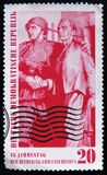 DDR Germany postage stamp shows Soviet soldier and civilaan handshakes, circa 1960 Royalty Free Stock Photography