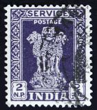 Indian postage stamp shows four Indian lions capital of Ashoka Pillar, circa 1958. MOSCOW, RUSSIA - APRIL 2, 2017: A post stamp printed in India shows four Royalty Free Stock Images