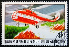 post stamp printed in Mongolia shows firefighting helicopter, circa 1977 Stock Image