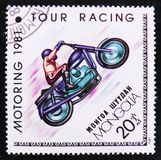 Four racing, Motoring serie, circa 1981. MOSCOW, RUSSIA - APRIL 2, 2017: A post stamp printed in Mongolia shows Four racing, Motoring serie, circa 1981 Royalty Free Stock Photo