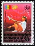 A post stamp printed in Mongolia shows Nadia Comaneci, circa 1976 Royalty Free Stock Image