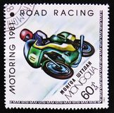 Road racing, Motoring serie, circa 1981. MOSCOW, RUSSIA - APRIL 2, 2017: A post stamp printed in Mongolia shows Road racing, Motoring serie, circa 1981 Stock Images