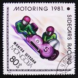 Sidecars racing, Motoring serie, circa 1981. MOSCOW, RUSSIA - APRIL 2, 2017: A post stamp printed in Mongolia shows Sidecars racing, Motoring serie, circa 1981 Stock Photos