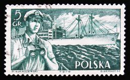 Ship captain and Polish Ships, circa 1956. MOSCOW, RUSSIA - APRIL 2, 2017: A post stamp printed in Poland, shows a ship captain and Polish Ships, circa 1956 Stock Photos