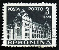 MOSCOW, RUSSIA - APRIL 2, 2017: A post stamp printed in Romania. Shows Central Post Office building, Bucharest, circa 1967 Stock Photography