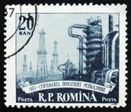 MOSCOW, RUSSIA - APRIL 2, 2017: A post stamp printed in Romania. Shows petroleum plant, circa 1957 Stock Photo