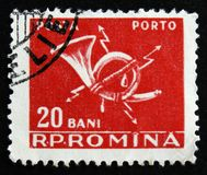 MOSCOW, RUSSIA - APRIL 2, 2017: A post stamp printed in Romania. Shows post horn, circa 1967 Stock Photos