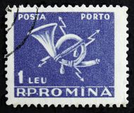 MOSCOW, RUSSIA - APRIL 2, 2017: A post stamp printed in Romania. Shows  post horn, circa 1967 Royalty Free Stock Photos
