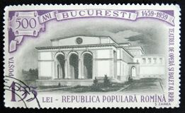 MOSCOW, RUSSIA - APRIL 2, 2017: A post stamp printed in Romania. Shows Opera House building, 500 anniversary of Bucharest, circa 1959 Stock Photo