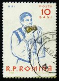 Peasants playing musical instruments, Panpipe, circa 1961. MOSCOW, RUSSIA - APRIL 2, 2017: A post stamp printed in Romania shows Peasants playing musical Stock Photo