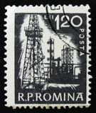 Romanian stamp shows Petroleum refinery, circa 1960. MOSCOW, RUSSIA - APRIL 2, 2017: A post stamp printed in Romania shows Petroleum refinery, circa 1960 stock photo
