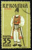 Romanian postage stamp shows Regional Costume, Oltenia, circa 1958. MOSCOW, RUSSIA - APRIL 2, 2017: A post stamp printed in Romania shows Regional Costume Stock Images