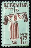 MOSCOW, RUSSIA - APRIL 2, 2017: A post stamp printed in Romania. Shows Woman in regional Costume, Moldova, circa 1958 Stock Photo