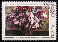 Paint Lilac by P. Kontchalovsky, 1933, circa 1974. MOSCOW, RUSSIA - APRIL 2, 2017: A post stamp printed in Russia, shows paint Lilac by P. Kontchalovsky, 1933 Stock Image