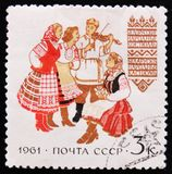 MOSCOW, RUSSIA - APRIL 2, 2017: A post stamp printed in USSR shows Belarusian national costumes, circa 1961 royalty free stock images