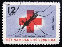 MOSCOW, RUSSIA - APRIL 2, 2017: A post stamp printed in Vietnam. Shows Soaking mosquito and red cross, Fights against Malaria, circa 1962 royalty free stock images