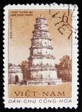 MOSCOW, RUSSIA - APRIL 2, 2017: A post stamp printed in Vietnam. Shows Thien Mu Pagoda in Hue city, circa 1962 stock image