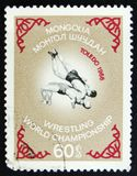 MOSCOW, RUSSIA - APRIL 2, 2017: A post stamp printed in Vietnam. Shows Two wrestlers, Wrestling World championship in Toledo, 1968, circa 1968 royalty free stock photography
