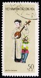 MOSCOW, RUSSIA - APRIL 2, 2017: A post stamp printed in Vietnam. Shows Woman playing banjo, circa 1975 stock image