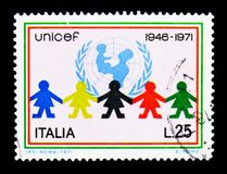 U.N.I.C.E.F., 25th Anniversary serie, circa 1971. MOSCOW, RUSSIA - APRIL 15, 2018: A stamp printed in Italy devoted to U.N.I.C.E.F., 25th Anniversary serie Stock Image