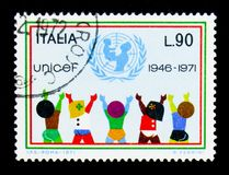 U.N.I.C.E.F., 25th Anniversary serie, circa 1971. MOSCOW, RUSSIA - APRIL 15, 2018: A stamp printed in Italy devoted to U.N.I.C.E.F., 25th Anniversary serie Royalty Free Stock Photos