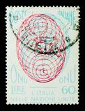 Globe designed with three-dimensional effect, UN (United Nations. MOSCOW, RUSSIA - APRIL 15, 2018: A stamp printed in Italy shows Globe designed with three royalty free stock photography