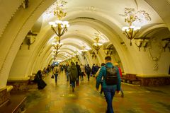 MOSCOW, RUSSIA- APRIL, 29, 2018: Unidentified people walking inside of Beautifully decorated metro station Arbatskaya. In Moscow Russia Royalty Free Stock Image