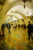 MOSCOW, RUSSIA- APRIL, 29, 2018: Unidentified people walking inside of Beautifully decorated metro station Arbatskaya. In Moscow Russia Stock Images