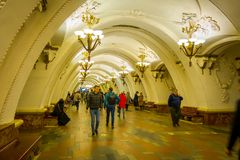 MOSCOW, RUSSIA- APRIL, 29, 2018: Unidentified people walking inside of Beautifully decorated metro station Arbatskaya. In Moscow Russia Royalty Free Stock Images