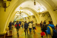 MOSCOW, RUSSIA- APRIL, 29, 2018: Crowd of people walking inside of Beautifully decorated metro station Arbatskaya, in. MOSCOW, RUSSIA- APRIL, 29, 2018 Stock Image
