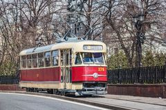 Vintage tram on the town street in the historical city center. Moscow, Russia - April 21, 2018: Vintage tram on the town street in the historical city center stock images