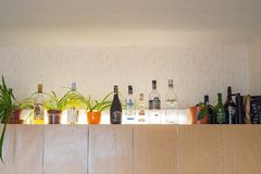 Free Moscow, Russia - August 3 2019: Home Bar On Shelf Cupboard With Standard Vodka, Absolut, Captain Morgan Rum Port Wine Royalty Free Stock Image - 154592706
