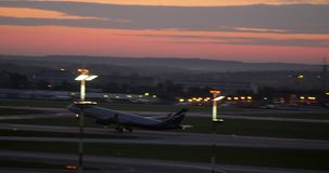 Aeroflot plane taking off in the dusk. Sheremetyevo Airport in Moscow stock footage
