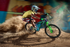 Biker riding with aggressive turns Stock Image