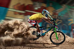 Biker riding with aggressive turns Royalty Free Stock Images