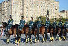 The cavalry honorary escort of the Presidential Regiment speaks against the background of the monument to the heroes of the First. MOSCOW, RUSSIA - AUGUST 22 Stock Photos