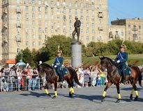 The cavalry honorary escort of the Presidential Regiment speaks against the background of the monument to the heroes of the First Royalty Free Stock Images