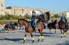 The cavalry honorary escort of the Presidential Regiment speaks against the background of the monument to the heroes of the First Royalty Free Stock Photos