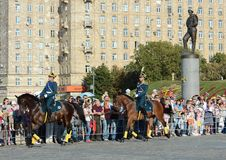 The cavalry honorary escort of the Presidential Regiment speaks against the background of the monument to the heroes of the First. MOSCOW, RUSSIA - AUGUST 22 Royalty Free Stock Photo